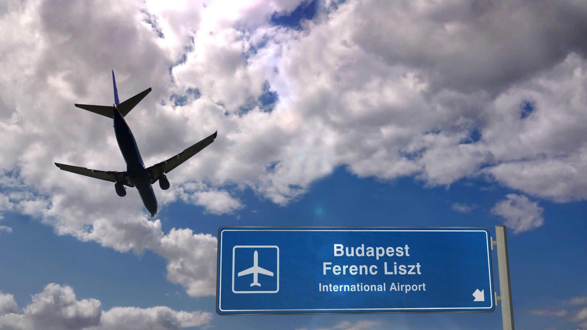Plane landing in Budapest Ferenc Liszt with signboard